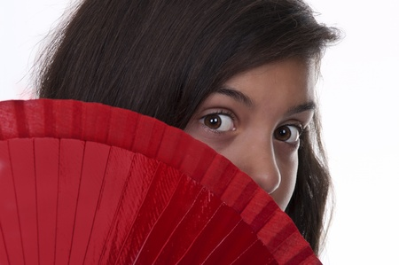 brunette teen girl with fan on white background Stock Photo - 10411820