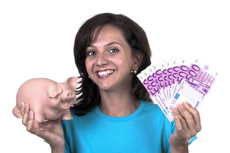 woman with piggy bank and 500 euro on white background photo