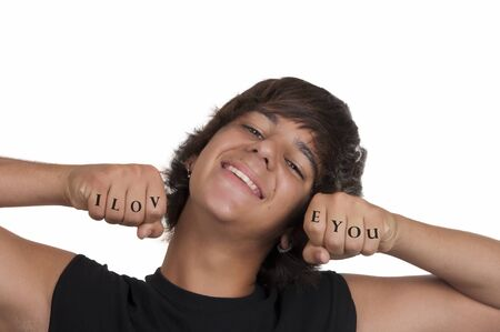 Smiling teenage boy in love on white background photo