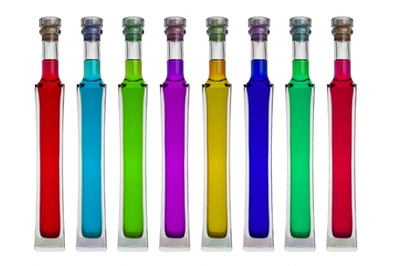 Bright colorful bottles  on white background photo