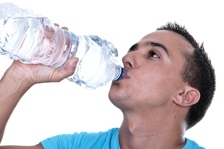 young Latino drinking water from a bottle photo