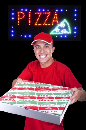 young pizza delivery man with the pizza neon sign photo