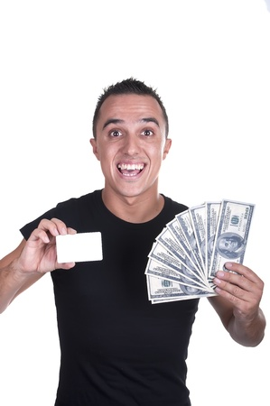 young man with a credit card and dollars on white background photo