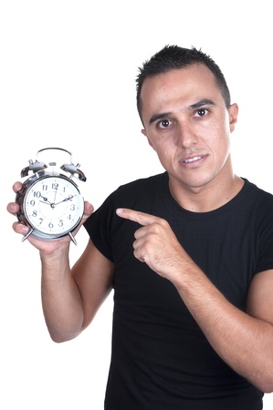 young man with alarm clock on white background photo
