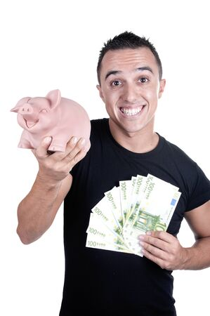 young man piggy bank and bills on white background photo