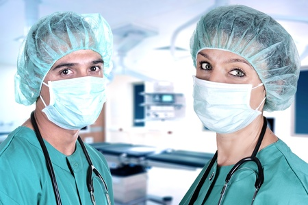 male and female surgeons in the operating room photo
