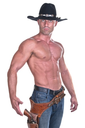 muscular cowboy with gun on white background photo