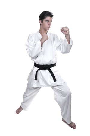 young  cuffs: Karate male fighter young  on white background