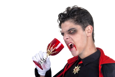 young vampire drinking blood on white background photo