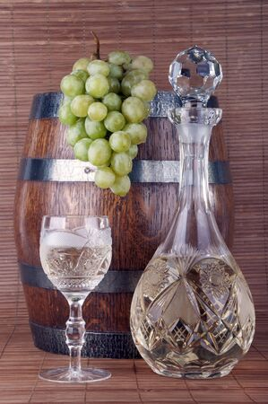 goblet: Bottle and glass of white wine with grapes