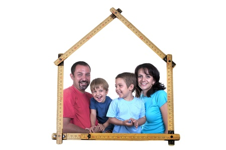 family forms meter stick into a house shape on white background photo