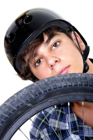 Young,  biker with BMX and looking at camera. Isolated on white background.  photo