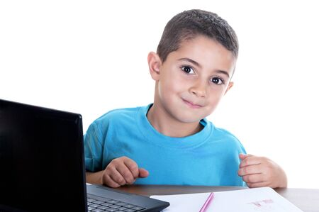 child studying with computer on white background photo