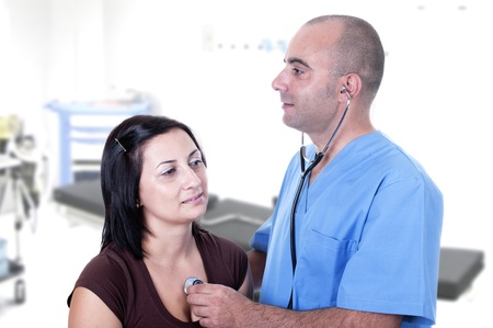 doctor will listen to a patient in his office Stock Photo