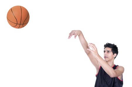 basketball player throwing the ball on white background photo
