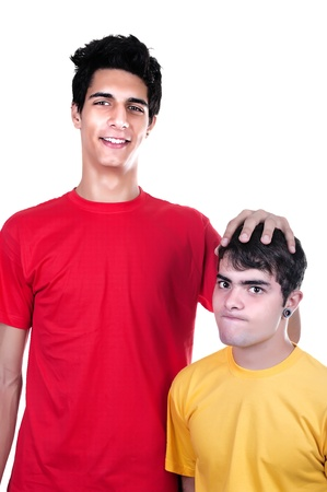 tall man: cute teen boys big and small on white background Stock Photo