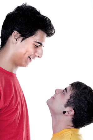 tall and short: cute teen boys big and small on white background Stock Photo