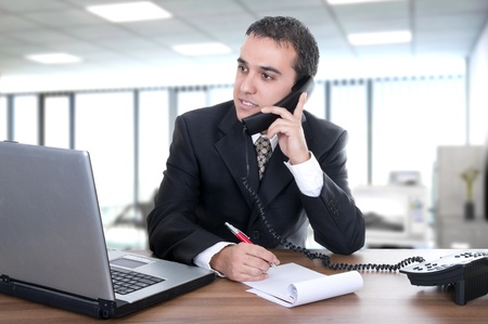 young businessman latino in office photo