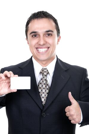 A smiling businessman holds out a credit card on white background