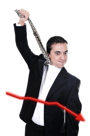 Stressed businessman hanging himself on his necktie isolated on white  photo