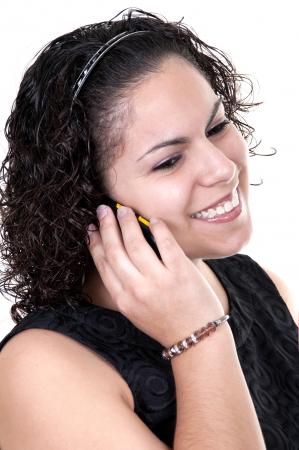 latina teen: Latina teen talking on the phone on white background