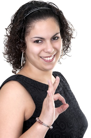 woman smiling doing the okay sign over a white background  photo