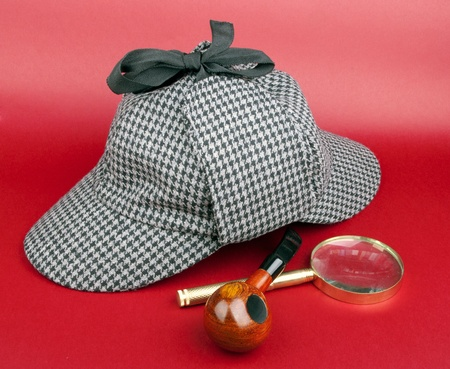 Detective Sherlock Holmes kit on red background