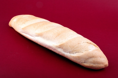 Fresh bread on red background photo