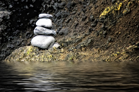 zen stones on the water in the mountains Stock Photo
