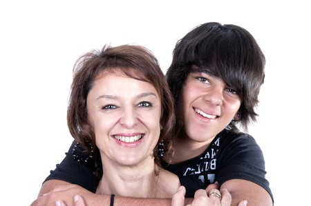 parents love: mother and son showing affection over a white background