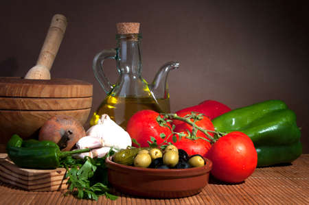 Composition with vegetables ,olive oil and herbs  photo