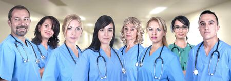 Team of medical professionals in hospital photo