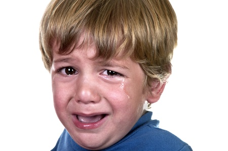 Closeup of a crying boy, studio shot  photo