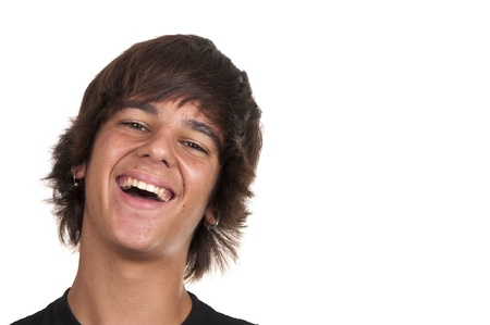 teenage boy smiling on white background photo
