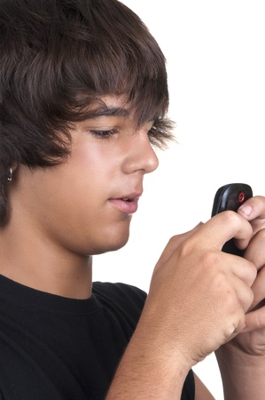 teenage boy calling from a mobile on white background photo