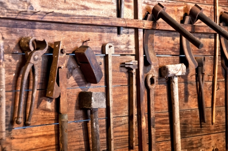 crate: old tools on a wooden board Stock Photo