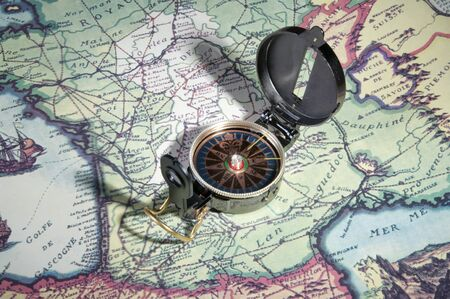 old compass on old map of france in europe photo