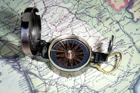 bygone: old compass on old map of france in europe Stock Photo