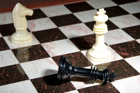 Chess pieces on wood board, black and white   Stock Photo
