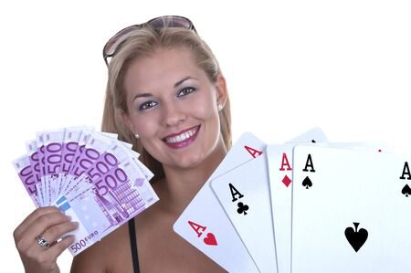 Blond Female model smiling while holding a poker hand of four aces and money photo