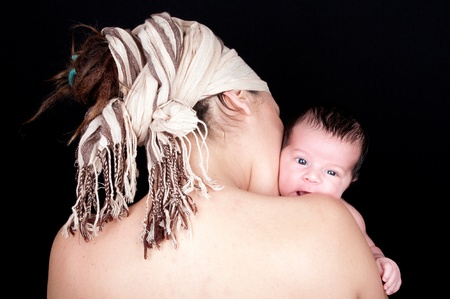 mother with newborn on black background Stock Photo - 15147899