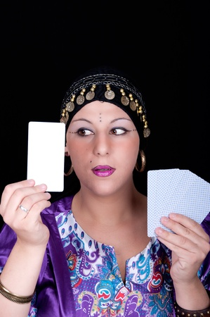 Gypsy fortune teller holding a blank tarot card  photo