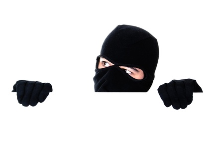 Robber hiding under a wall on white background
