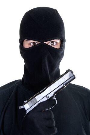 headgear: Masked man aims with gun on white background Stock Photo