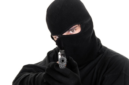 stealer: Masked man aims with gun , selective focus