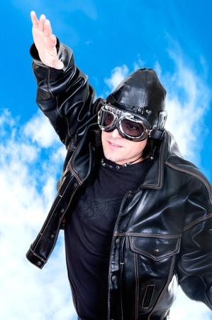 adventure aeronautical: retro aviator on blue sky