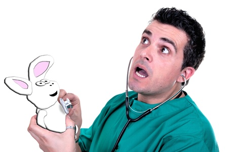 nuthouse: Young and crazy doctor using a stethoscope with a rabbit Stock Photo