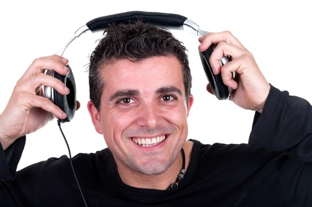 man listening to music with headphones photo