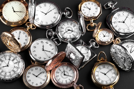vintage pocket watches on black background photo