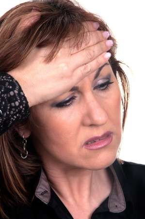 ma: business woman with headache holding hand at head  Stock Photo